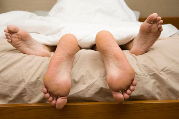 View of feet of couple